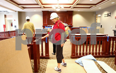 Kyle Bursaw – kbursaw@shawmedia.com  Ruth Anne Tobias, chair of the Ad Hoc Courthouse Committee, looks at the pieces installed in what will be the new the high traffic courtroom in the expansion of the DeKalb County Courthouse on Wednesday, May 23, 2012.