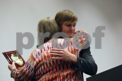 Rob Winner – rwinner@shawmedia.com  Nursing student Garrett Burton (right) presents director of nursing Heather Peters with a plaque before his student address during a pinning ceremony at Kishwaukee College in Malta Saturday morning.