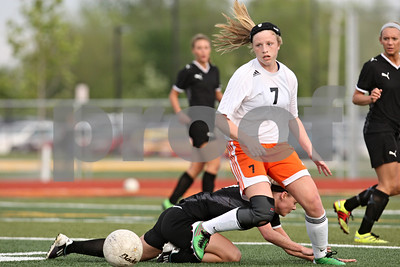 Rob Winner – rwinner@shawmedia.com  DeKalb's Abby Hickey (7) controls a ball as Sycamore's Emma Floit goes down during the first half in DeKalb Tuesday, May 8, 2012. Sycamore defeated DeKalb, 3-1.