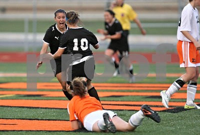Rob Winner – rwinner@shawmedia.com  Sycamaore's Emma Norris (left) and Michelle Doran (10) celebrate Doran's first goal during the second half in DeKalb Tuesday, May 8, 2012. Sycamore defeated DeKalb, 3-1.