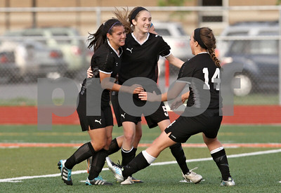 Rob Winner – rwinner@shawmedia.com  Emma Norris (left) celebrates her first half goal with her teammates including Lauren Miller (center) and Katherine Kohler during the first half in DeKalb Tuesday, May 8, 2012. Sycamore defeated DeKalb, 3-1.
