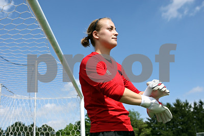Rob Winner – rwinner@shawmedia.com  Northern Illinois goalkeeper Amy Carr works out on the NIU soccer field Thursday in DeKalb. Carr is traveling to South Africa this summer to hold youth soccer camps.
