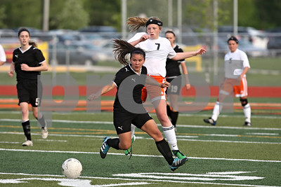 Rob Winner – rwinner@shawmedia.com  Sycmaore's Emma Norris (front) and DeKalb's Abby Hickey chase after a ball during the first half in DeKalb Tuesday, May 8, 2012. Sycamore defeated DeKalb, 3-1.