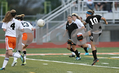 Rob Winner – rwinner@shawmedia.com  Sycamore's Michelle Doran (10) kicks in her second goal during the second half in DeKalb Tuesday, May 8, 2012. Sycamore defeated DeKalb, 3-1.