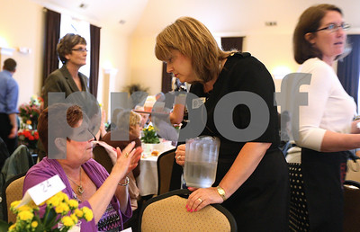 Kyle Bursaw – kbursaw@shawmedia.com  Laura Frankiewicz chats with State Senator Christine Johnson at the Meals for Moms lunch fundraiser for the Voluntary Action Center. Johnson and District 427 Assistant Superintendent Kathy Countryman (right) were just a few of the volunteer servers for the event held at the Regale Center in Sycamore, Ill. on Monday, May 7, 2012.