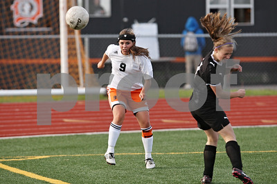 Rob Winner – rwinner@shawmedia.com  DeKalb's Alli Smith clears a ball during the first half in DeKalb Tuesday, May 8, 2012. Sycamore defeated DeKalb, 3-1.