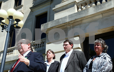 Kyle Bursaw – kbursaw@shawmedia.com  Attorney Richard Schmack (left) publicly announces his intention to run for DeKalb County State's Attorney in front of the DeKalb County Courthouse on Thursday, May 10, 2012.