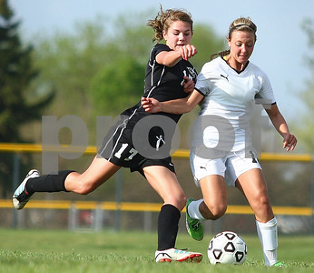 Kyle Bursaw – kbursaw@shawmedia.com  Sycamore's Sarah Papini and Kaneland's Courtney Diddell chase after the ball during the first half of their game in Sycamore, Ill. on Thursday, May 3, 2012.
