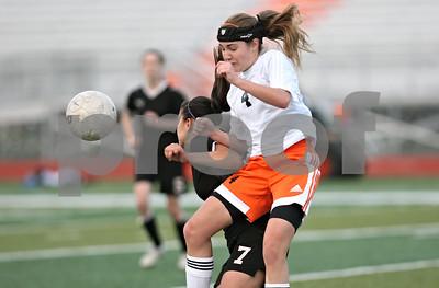 Rob Winner – rwinner@shawmedia.com  DeKalb's Morgan Beaty (4) and Sycamore's Emma Norris (7) struggle for a ball during the second half in DeKalb Tuesday, May 8, 2012. Sycamore defeated DeKalb, 3-1.