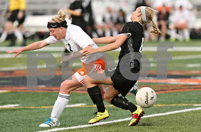 Rob Winner – rwinner@shawmedia.com  DeKalb's Kelli Cardine (2) and Sycamore's Kieley Leach go to the ground after colliding during the first half in DeKalb Tuesday, May 8, 2012. Sycamore defeated DeKalb, 3-1.
