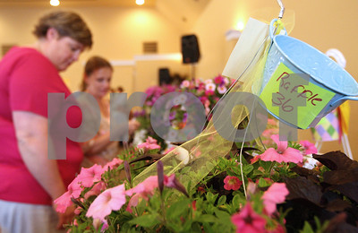 Kyle Bursaw – kbursaw@shawmedia.com  Two women investigate the items up for raffle at the Meals for Moms lunch fundraiser held at the Regale Center in Sycamore, Ill. on Monday, May 7, 2012.