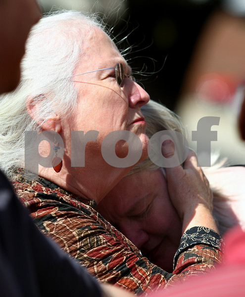 Kyle Bursaw – kbursaw@shawmedia.com<br /> <br /> Jeanne Tessier (left) embraces her sister Janet outside the DeKalb County Courthouse following the guilty verdict of their half-brother Jack McCullough for the 1957 kidnapping and murder of Maria Ridulph in Sycamore, Ill. on Friday, Sept. 14, 2012.