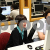 "Kyle Bursaw – kbursaw@shawmedia.com<br /> <br /> Laura Vazquez, an NIU professor, reacts as she watches the video student Jon Rosenbloom (right) is producing of NIU's Take Back the Night event in October, in a Watson Hall computer lab on Thursday, Nov. 1, 2012. Vazquez received a Distinguished Service and Leadership Award from the National Association for the Education of Homeless Children and Youth for her documentary work on homelessness, her latest work is ""on the edge: Family Homelessness in America."""