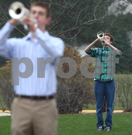 Kyle Bursaw – kbursaw@shawmedia.com<br /> <br /> Students Jon Cordes (front) and Ben Van Wienen play taps as the flag is lowered honoring Veterans Day before school at Sycamore High School on Friday, Nov. 9, 2012.