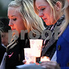 Kyle Bursaw – kbursaw@shawmedia.com<br /> <br /> Northern Illinois University students Mary Jane Meisenheimer (left) and Lindy Luchowski, both friends of David Bogenberger, participate in a candlelight vigil for Bogenberger outside the Holmes Student Center on Wednesday, Nov. 7, 2012.