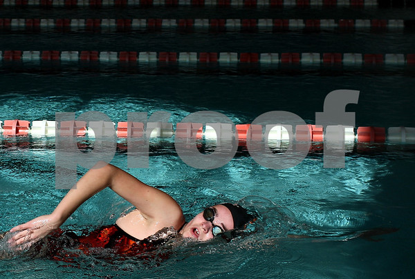Kyle Bursaw – kbursaw@shawmedia.com<br /> <br /> Sam LeBlanc swims freestyle at practice as the afternoon sunlight comes into the Huntley Middle School pool on Friday, Nov. 2, 2012. Several DeKalb/Sycamore co-op swimmers will compete at sectionals on Saturday Nov. 10.