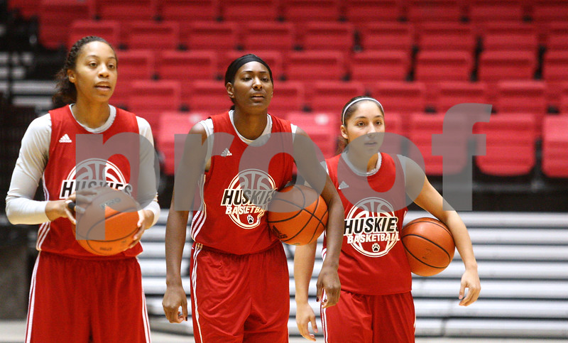 Kyle Bursaw – kbursaw@shawmedia.com<br /> <br /> Northern Illinois University women's basketball players (from left) Satavia Taylor, Jada Buggs and Amanda Corral wait their turn to run a drill at practice in the Convocation Center on Thursday, Nov. 1, 2012.