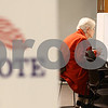 Kyle Bursaw – kbursaw@shawmedia.com<br /> <br /> Genoa resident Janet Brooks looks over her ballot while voting early in Sycamore, Ill. on Monday, Nov. 5, 2012.