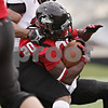 Rob Winner – rwinner@shawmedia.com<br /> <br /> Northern Illinois running back Keith Harris Jr. (20) scores on a 1-yard touchdown run during the first quarter in DeKalb, Ill., Saturday, Nov. 3, 2012. NIU defeated Massachusetts, 63-0.