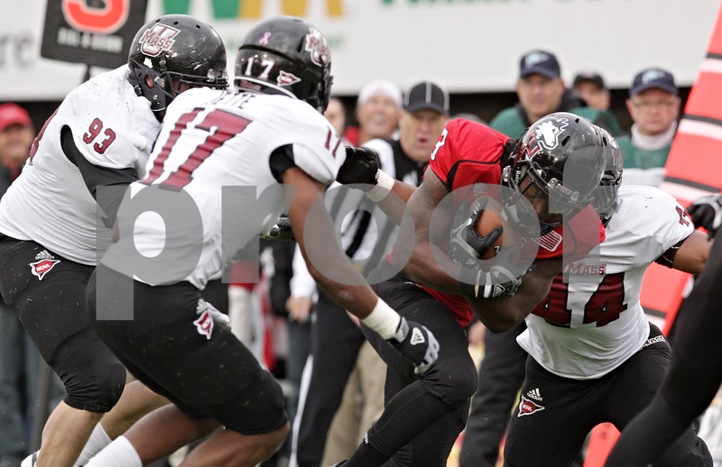 Rob Winner – rwinner@shawmedia.com<br /> <br /> Northern Illinois running back Akeem Daniels (3) gets into the end zone after a 17-yard pass from quarterback Jordan Lynch (not pictured) during the second quarter in DeKalb, Ill., Saturday, Nov. 3, 2012. NIU defeated Massachusetts, 63-0.