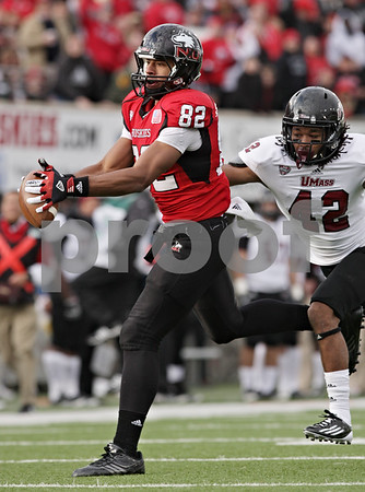 Rob Winner – rwinner@shawmedia.com<br /> <br /> Northern Illinois wide receiver Juwan Brescacin (82) hauls in a 44-yard pass from Jamison Wells (not pictured) during the second quarter in DeKalb, Ill., Saturday, Nov. 3, 2012. NIU defeated Massachusetts, 63-0.
