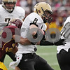 Rob Winner – rwinner@shawmedia.com<br /> <br /> Sycamore wide receiver Ben Niemann (8) receives a pass from Devin Mottet (not pictured) in the second quarter of a Class 5A playoff game in Lombard, Ill., Saturday, Nov. 3, 2012. Montini defeated Sycamore, 24-22.