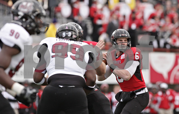 Rob Winner – rwinner@shawmedia.com<br /> <br /> Northern Illinois quarterback Jordan Lynch (6) looks before throwing a touchdown to wide receiver Martel Moore (not pictured) during the first quarter in DeKalb, Ill., Saturday, Nov. 3, 2012. NIU defeated Massachusetts, 63-0.