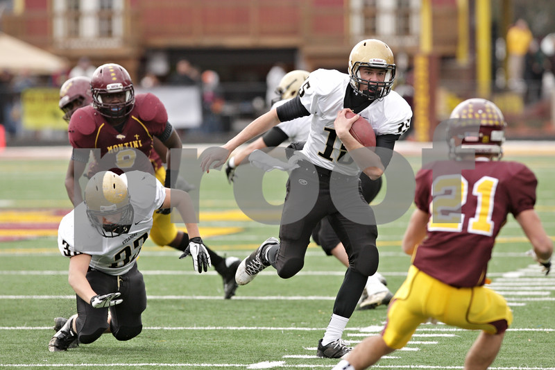 Rob Winner – rwinner@shawmedia.com<br /> <br /> Sycamore quarterback Devin Mottet carries the ball in the first quarter of a Class 5A playoff game in Lombard, Ill., Saturday, Nov. 3, 2012. Montini defeated Sycamore, 24-22.