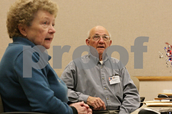Rob Winner – rwinner@shawmedia.com<br /> <br /> Election judges Catherine Cwiklinski, a Republican, and her husband John Cwiklinksi, a Democrat, help voters at the Legislative Center in Sycamore Thursday, Nov. 1, 2012.