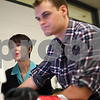 "Kyle Bursaw – kbursaw@shawmedia.com<br /> <br /> Laura Vazquez, an NIU professor, works with student Nick Fleming on exporting a video project of SlutWalk Chicago in a Watson Hall computer lab on Thursday, Nov. 1, 2012. Vazquez received a Distinguished Service and Leadership Award from the National Association for the Education of Homeless Children and Youth for her documentary work on homelessness, her latest work is ""on the edge: Family Homelessness in America."""