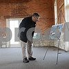 Rob Winner – rwinner@shawmedia.com<br /> <br /> Kent Wrenn looks over a photograph of the Sycamore train depot from 1974 during a house walk inside the community meeting room at the depot in Sycamore on Saturday, Oct. 27, 2012. The historical building is now home to the DeKalb County Community Foundation.