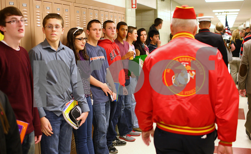 Kyle Bursaw – kbursaw@shawmedia.com<br /> <br /> Sycamore High School students look on as veterans including Don Jones (red marine corps jacket) and other students march through the hallways honoring Veterans Day on Friday, Nov. 9, 2012.