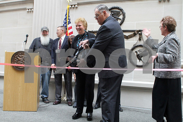 Judge Kurt Klein dedicates the newly expanded DeKalb County Courthouse with a ribbon cutting ceremony while the other Expansion Board members look on.<br /> <br /> Gary L. Gates / For the Daily Chronicle