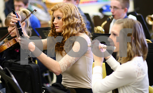 Kyle Bursaw – kbursaw@shawmedia.com<br /> <br /> Lillian Rabe (left) assembles her clarinet at the start of band class in Somonauk High School on Tuesday, Nov. 13, 2012.