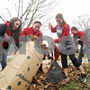 Rob Winner – rwinner@shawmedia.com<br /> <br /> Members of the Northern Illinois softball team including Jillian Mattor (from left to right), Stephanie Wonders and Emily Woller clear leaves from the yard outside the DeKalb Area Women's Center during the Rake Across DeKalb event Saturday, Nov. 10, 2012.
