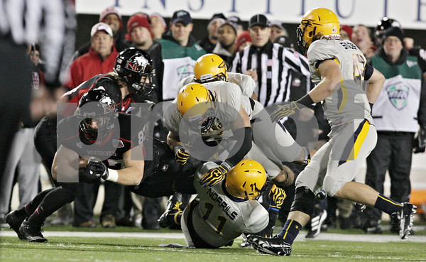 Rob Winner – rwinner@shawmedia.com<br /> <br /> Northern Illinois tight end Jason Schepler (87) gains 23 yards on a pass from Jordan Lynch (not pictured) during the first quarter in DeKalb, Ill., Wednesday, Nov. 14, 2012. NIU defeated Toledo, 31-24.