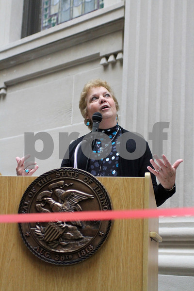 Courthouse Expansion Chairman Ruthanne Tobias gestures up while speaking about the recently completed DeKalb Courthouse expansion on Sunday.<br /> <br /> Gary L. Gates / For the Daily Chronicle