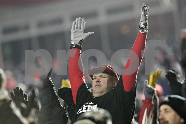 Rob Winner – rwinner@shawmedia.com<br /> <br /> A Northern Illinois fan celebrates a touchdown by wide receiver Martel Moore during the third quarter.