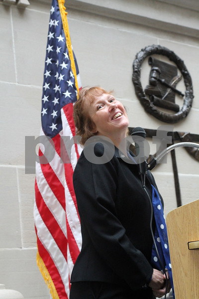 Honored guest and military veteran Laurie Emmer speaks about her military experiences during the Memorial Day and Courthouse expansion ceremonies on Sunday.<br /> <br /> Gary L. Gates / For the Daily Chronicle