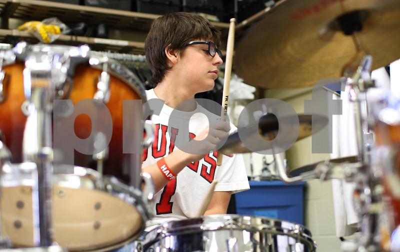 Kyle Bursaw – kbursaw@shawmedia.com<br /> <br /> David Burton plays the drum kit during band class at Somonauk High School on Tuesday, Nov. 13, 2012.