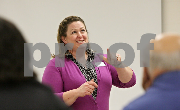 Rob Winner – rwinner@shawmedia.com<br /> <br /> Paula Fisher, of Manpower, speaks to parents attending Tuesday night's YESS Parent University Program at Sycamore High School. YESS stands for Youth Experiencing Success in School. Tuesday's program focused on a student's life after high school.
