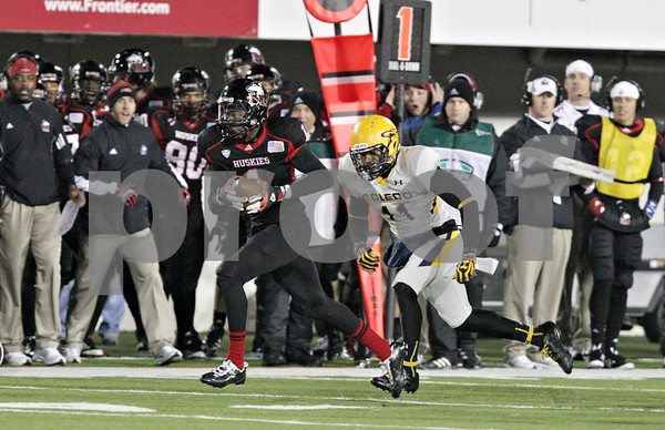 Rob Winner – rwinner@shawmedia.com<br /> <br /> Northern Illinois wide receiver Martel Moore (1) heads for the end zone for a 73-yard touchdown pass during the third quarter in DeKalb, Ill., Wednesday, Nov. 14, 2012. NIU defeated Toledo, 31-24.