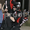 Rob Winner – rwinner@shawmedia.com<br /> <br /> Northern Illinois wide receiver Martel Moore (1) is lifted up by Jordan Lynch (6) after a 73-yard touchdown pass to begin the third quarter in DeKalb, Ill., Wednesday, Nov. 14, 2012. NIU defeated Toledo, 31-24.