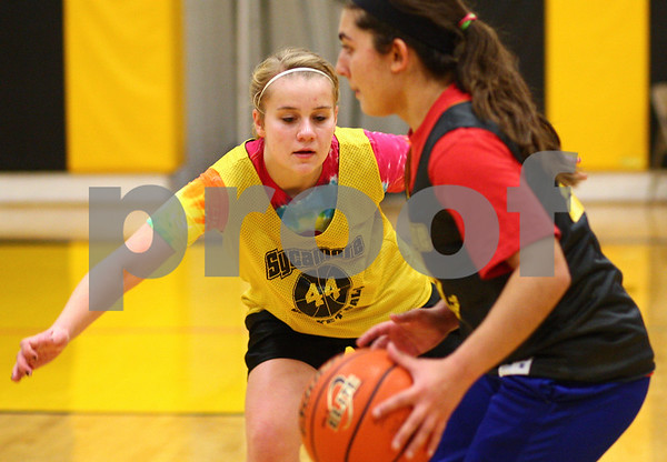 Kyle Bursaw – kbursaw@shawmedia.com<br /> <br /> Sycamore's Jessica Mollman defends teammate Julia Moll during a drill at <br /> practice on Thursday, Nov. 1, 2012.
