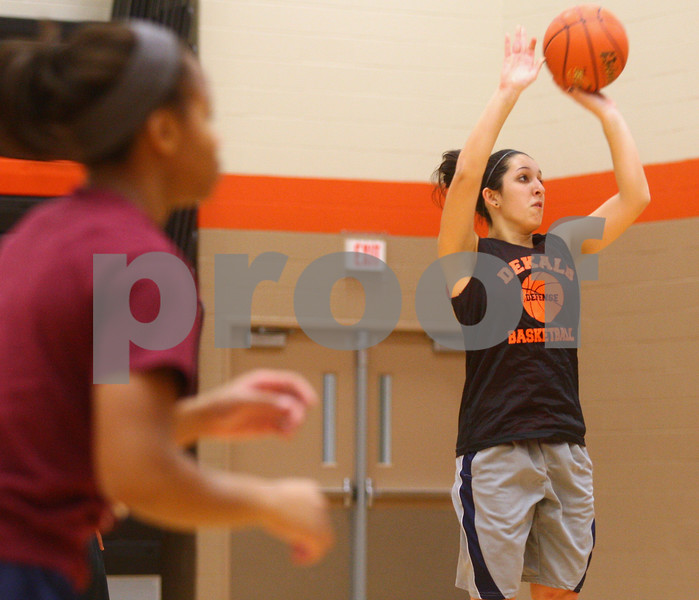 Kyle Bursaw – kbursaw@shawmedia.com<br /> <br /> DeKalb's Rachel Torres takes a shot at practice at DeKalb High School on Tuesday, Oct. 30, 2012.
