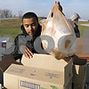 Rob Winner – rwinner@shawmedia.com<br /> <br /> Travis deOliveira, 14, of Boy Scout Troop 33, helps sort items to benefit victims of Hurricane Sandy during a supply drive outside Algus Packaging, Inc. in DeKalb,   Ill., Saturday, Nov. 17, 2012. deOliveira and fellow scouts will be traveling to New Jersey on Tuesday to deliver the supplies collected during Saturday's drive.