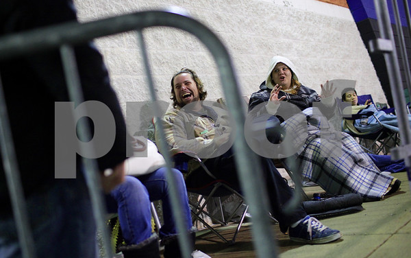 Kyle Bursaw – kbursaw@shawmedia.com<br /> <br /> John and Angela Davis, of DeKalb, joke around with their fellow shoppers waiting near the front of the line at Best Buy in DeKalb, Ill. on Thursday, Nov. 22, 2012.