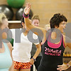 Rob Winner – rwinner@shawmedia.com<br /> <br /> Fitness instructor Jill Farris (right) leads a zumba class during the Be Thankful Workout event at the DeKalb Park District Sports and Recreation Center early Thursday morning. Donations to benefit Ronald McDonald House were accepted as well as non-perishable goods for the Salvation Army's food pantry.