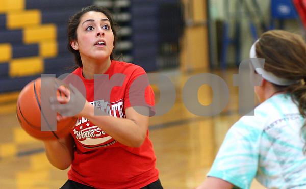 Kyle Bursaw – kbursaw@shawmedia.com<br /> <br /> Hiawatha's Desiree Andujar looks for a shot against the defense of Ashley Tamraz during practice on Monday, Oct. 29, 2012.