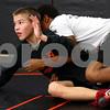 Kyle Bursaw – kbursaw@shawmedia.com<br /> <br /> DeKalb's Parker Stratton tries to escape teammate Izaiah Webb during a drill at practice on Tuesday, Nov. 20, 2012.